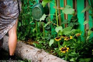 Watering the Shambhala garden. Courtesy of Xavier Walker Photography