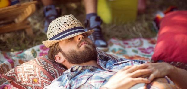 man-sleeping-outside-festival-3